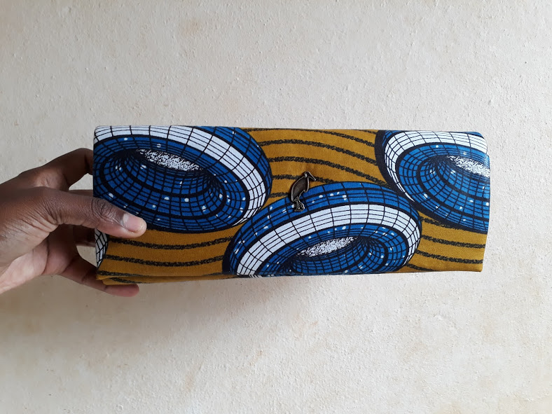 African print blue and brown clutch bag