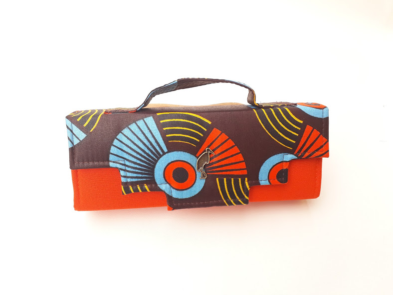 orange african print clutch bag. Timbuktu
