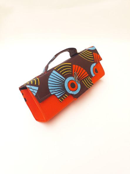 orange african print clutch bag. Timbuktu